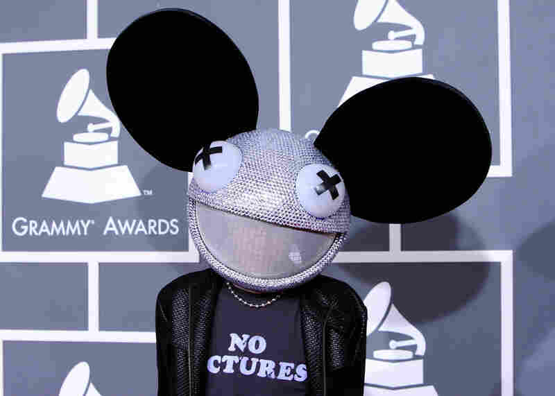House music producer Deadmau5 poses for a picture despite his own T-shirt.