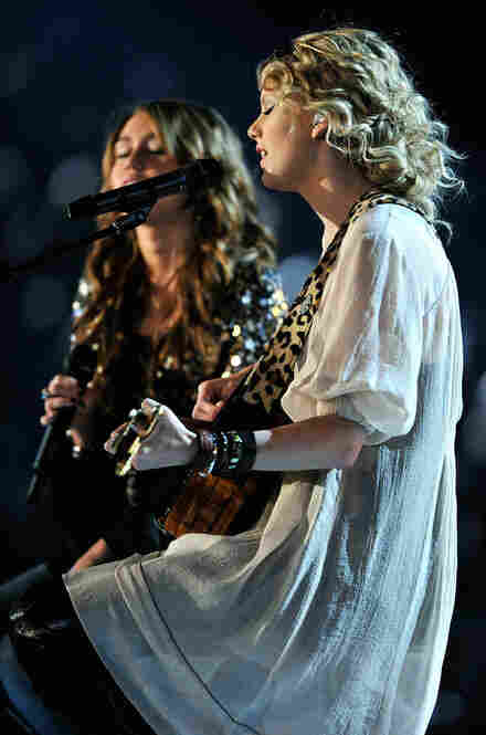"Miley Cyrus (left) and Taylor Swift paired up on Swift's song, ""Fifteen."""