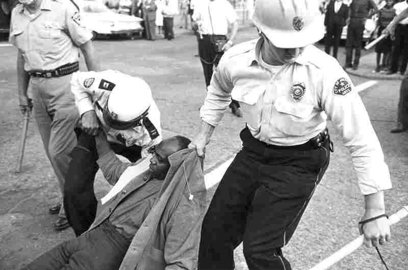 Policemen drag a protester away from an anti-segregation march in Jackson, Miss., on May 31, 1963.