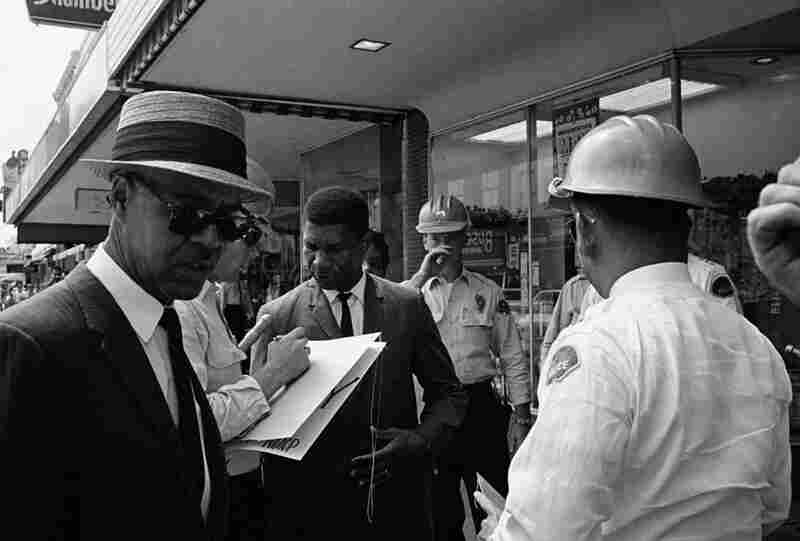 Police arrest NAACP leaders Roy Wilkins (left) and Medgar Evers (center) for picketing in downtown Jackson, Miss., on June 1, 1963.  Evers was murdered just a few days later by Byron De La Beckwith, a member of the Ku Klux Klan.