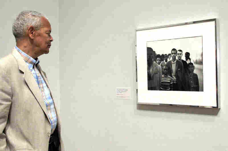Julian Bond, chairman of the NAACP since 1998, looks at a portrait of himself that was taken by renowned photographer Richard Avedon in 1963, when Bond was a member of the Student Nonviolent Coordinating Committee.