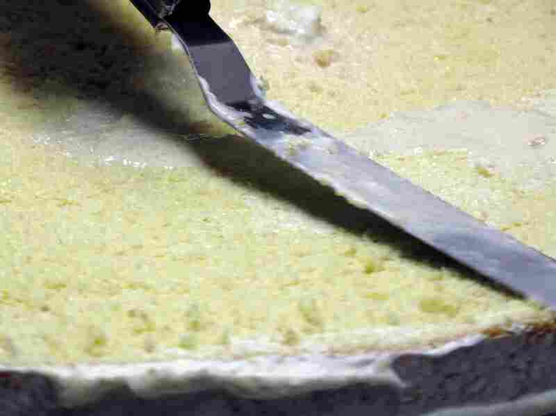 The liquid is pressed into the cake with a pastry spatula.
