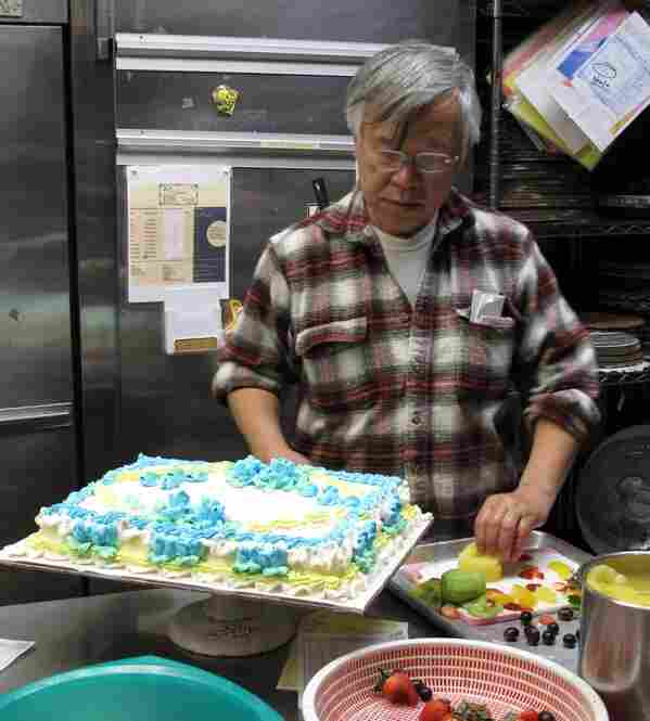 In the mean time Mahn Phung finishes the decorating on another cake.