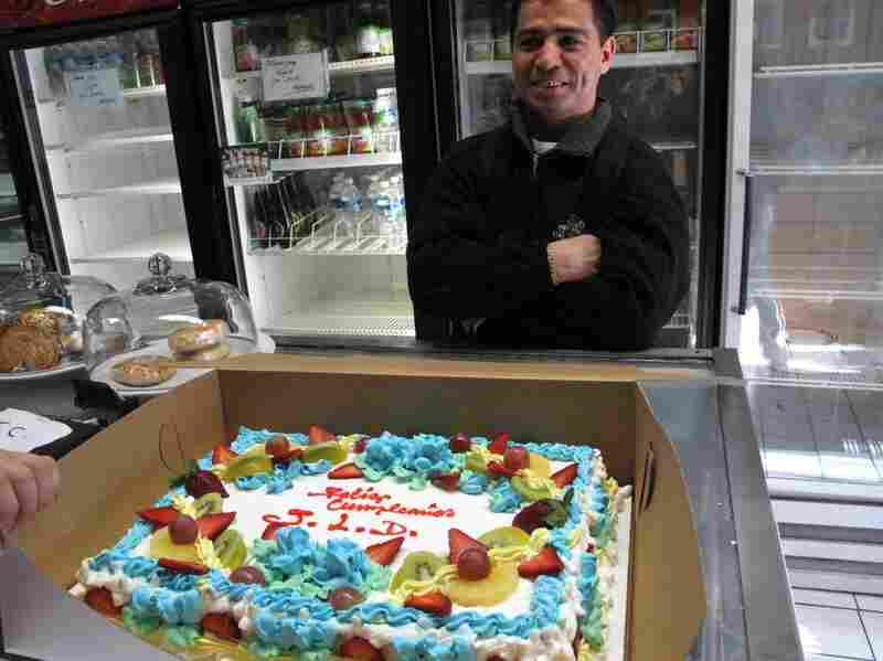 Juan Luis is happy with his cake and knows his brother will be having a very Feliz Compleano once he arrives home.