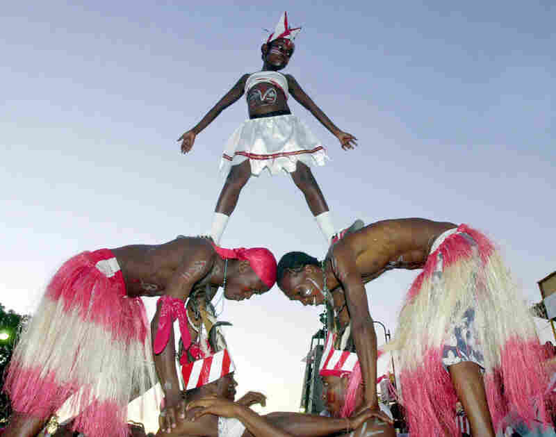 In Haiti, dancers step out for a parade on Mardi Gras or Fat Tuesday.