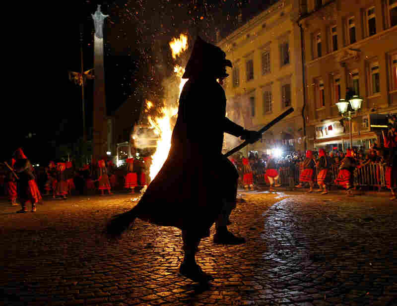 In Offenburg, Germany, revelers in witch costumes dance around a burning straw puppet. Burning a witch effigy — customary in Fasching or Karneval festivals in Germany, Switzerland and Austria — represents expelling evil spirits.