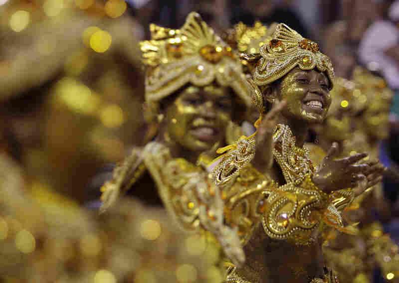Dancers perform during the Vila Isabel samba school parade in Rio de Janeiro.
