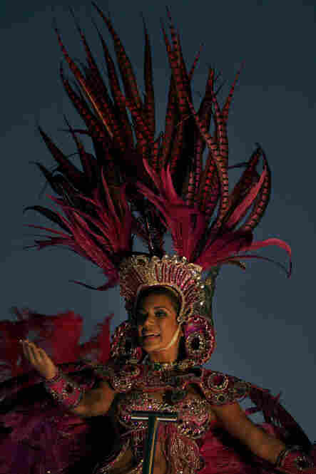 A carnival queen weaves through the crowd during celebrations in Panama City.