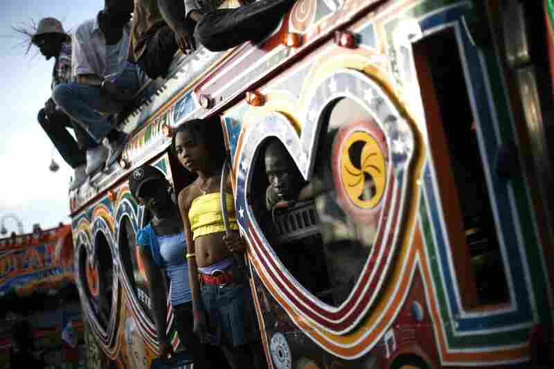 Observers watch a carnival parade from a Haitian tap-tap, or bus, in Port-au-Prince.