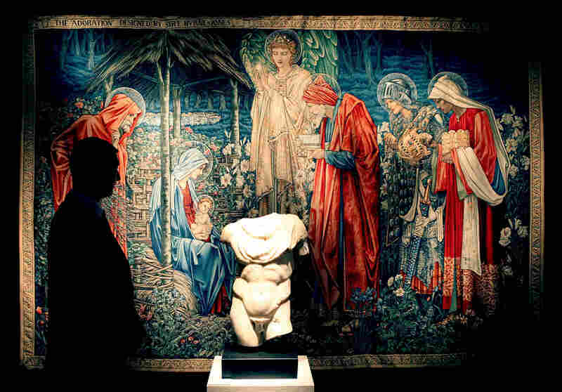 A Christie's employee stands in front of a 1904 tapestry by Sir Edward Coley Burne-Jones and a 1st-2nd century marble torso.  Berge said he would use a large portion of the $484 million to support AIDS research.