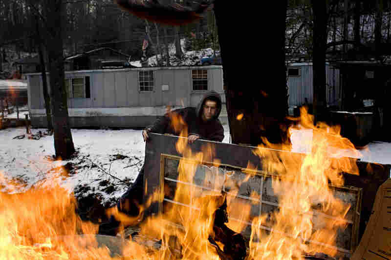 Tylor Woodrum, 16, burns trash in the backyard of his stepmother's house in Carbondale. His father, Dave Woodrum, was killed in a high-impact four-wheeler accident in 2006.