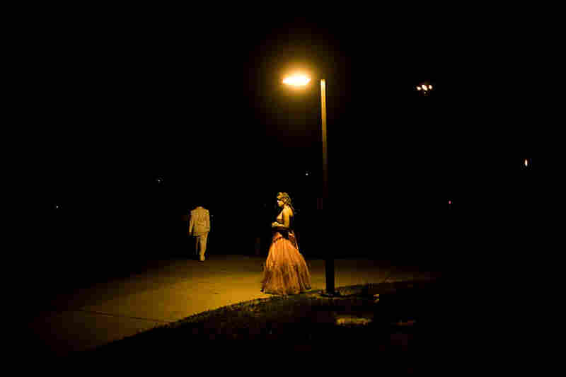 Kiah Chonko, 15, of Athens High School waits for her ride after prom in Nelsonville.