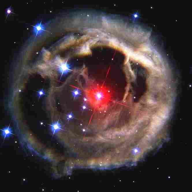 Light echoes from red supergiant star V838 Monocerotis in the constellation Monoceros, or the Unicorn, in December 2002.