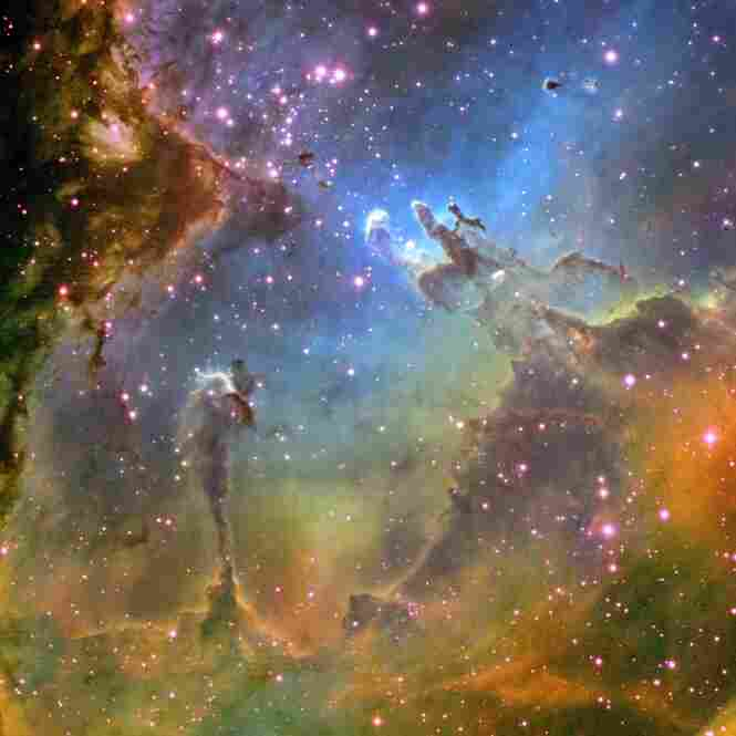 This Hubble image shows the Eagle Nebula, a young cluster of stars in the constellation Serpens.