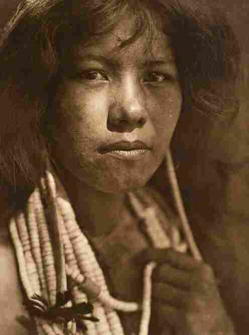 """Edward S. Curtis lived in the early 1900s as photographer of the American West and of American Indian peoples.  Titled """"A Pomo Girl,"""" this image captures a member of one of the many communities indigenous to California.  Image courtesy George Eastman House Collection"""