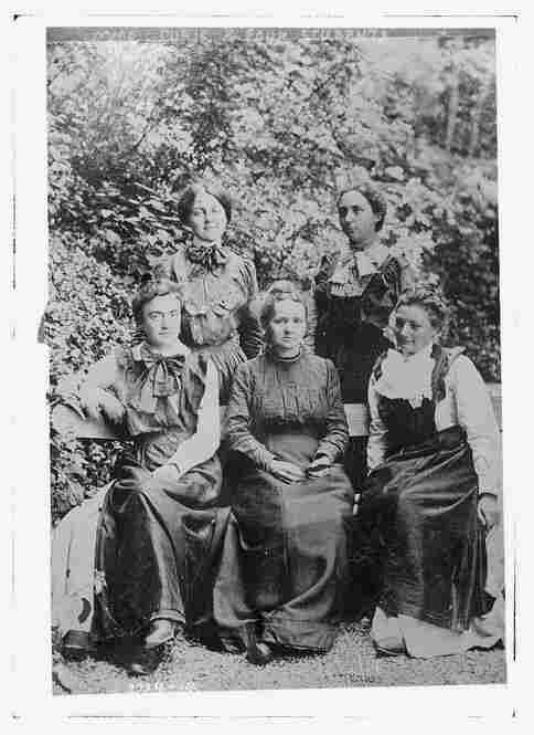 Marie Curie, surrounded by students circa 1910, was a physicist and chemist of Polish descent.  She was a pioneer in the scientific field of radioactivity and was the first twice-honored Nobel laureate — clearly thrilled by her accomplishments.  Image courtesy Library of Congress
