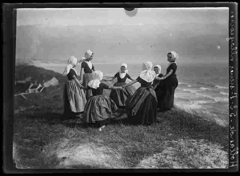 """French photographer Charles Chusseau-Flaviens captured this image titled """"Hollande scenes villageoises,"""" or Holland villager scenes, in the early 1900s.  Apparently female Hollanders lived on the edge — quite literally as they are about to ring-around-the-rosy right off a cliff.  Image courtesy George Eastman House Collection"""
