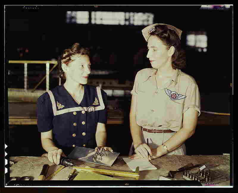 Pearl Harbor widow Virginia Young (right), whose husband was one of the first casualties of World War II, was a supervisor in the Assembly and Repairs Department of the Naval Air Base, circa 1942.  Like many women during WWII, these two took up the responsibility of providing for their families. Image courtesy Library of Congress
