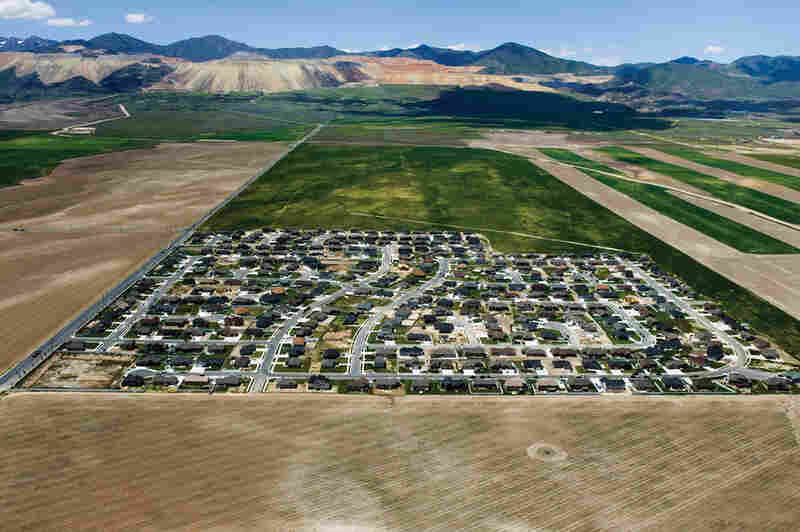 Isolated exurban communities in Utah built on cheap agricultural land depend on cars for nearly every activity. To access urban centers, residents often have to commute long distances. Because the land is virtually undeveloped, all aspects of modern infrastructure (water, sewer, electric and roads) must be extended.