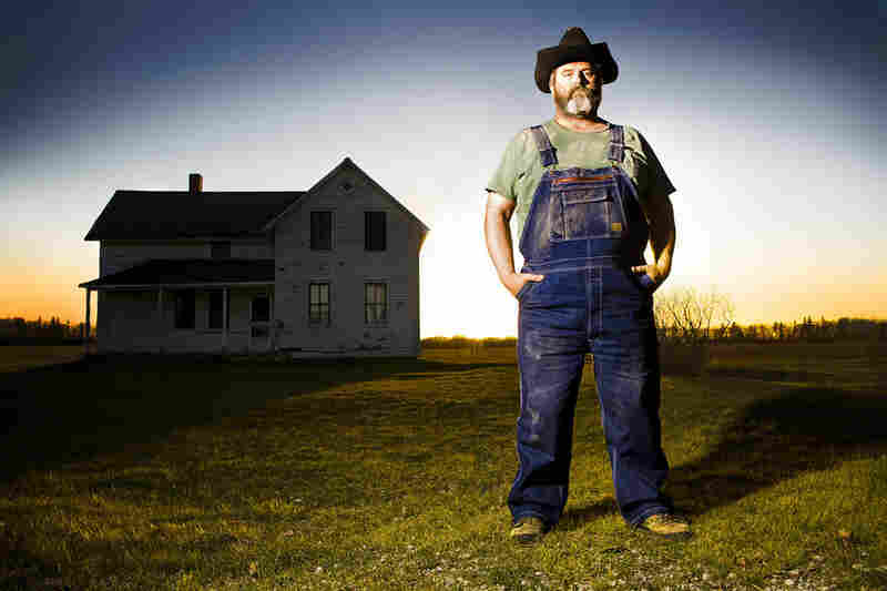 Doug Manning stands on his apple and sweetgrass farm in Empire, Mich., a village with a population of 378 in 2000.