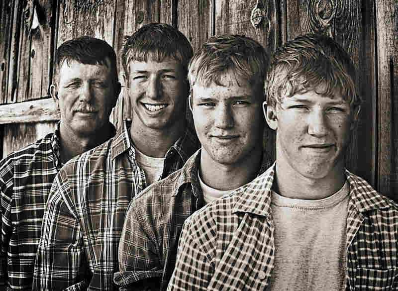 Stan Horton (left) stands with his sons, Garrett, Shay and Brent on their alfalfa farm near Riverton, Wyo.