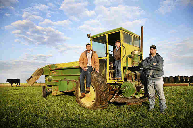 """""""There's a story behind each parcel of this ground,"""" says Keith Nelson (left), posing with his son-in-law, Brian Lacina, and grandson, Trey Lacina, on their cattle farm in Crawford, Texas."""