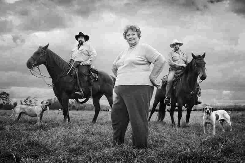 "Imogene Yarborough with her sons, Bo and J.W., raise cattle in Geneva, Fla.  The Yarborough farm has been in the family for five generations. ""Right now,"" says Imogene, ""if you are in the cow business, you either married it or inherited it — because of the price it takes to buy land and cattle, and to get set up. The value of the dollar is just not there. It takes so much more to live now."""