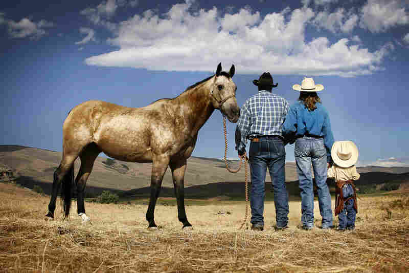 """Thad and Andrea Dockery, cattle ranchers in Jeffrey City, Wyo., stand with their daughter, Laura.  """"We love our land and the way of life,"""" says Andrea."""