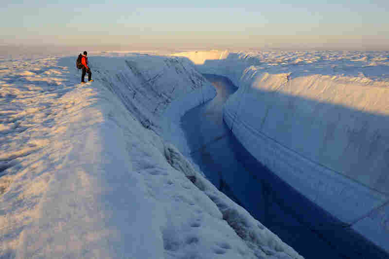 Director of photography Michael Brown looks over Meltwater Canyon in Greenland.  From here to the Alps, Balog and his team have made a vi