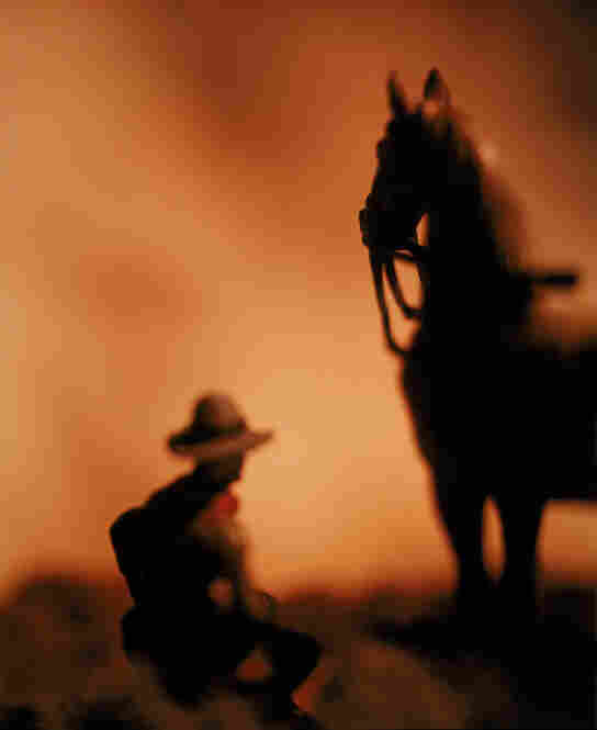 Untitled, from the series The Wild West, 1989David Levinthal, born 1939, pairs dolls and toys with dramatic lighting to recreate miniature scenarios, such as this cinematic Western scene.  2009 David Levinthal)
