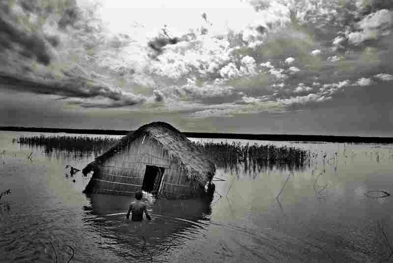 """Bangladeshi photographer Munem Wasif has a series called """"A Tale of Paradise Lost--Climate Refugee in Bangladesh.""""  """"Every year,"""" he says, """"rivers are becoming more violent while people living beside them are becoming more vulnerable."""" The people have a"""