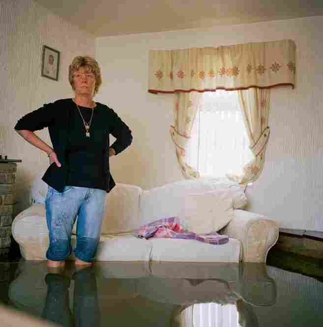 Photographer Gideon Mendel captured Margaret Clegg in her living room after a devastating flash flood in northern England. Flooded Living Room, 2007, Toll Bar Village, near Doncaster, UK