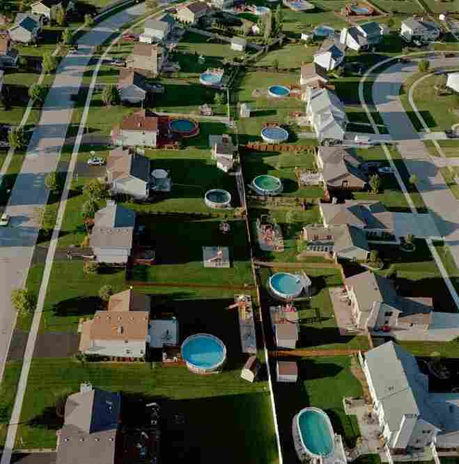 Terry Evans is a photographer of stunningly simple aerials and landscapes, many of which examine human impact on the environment. Backyard Pools, Will County, Ill., U.S.A., 2003