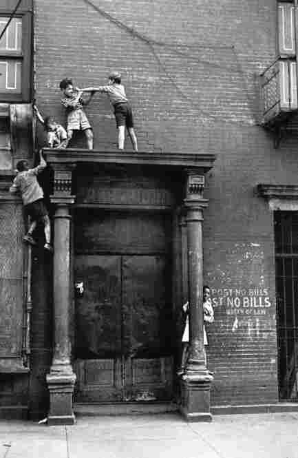 Kids over doorway, New York, circa 1940