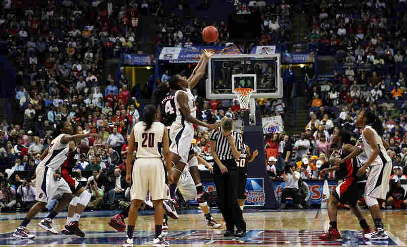 The referee shies from the tip-off between the Huskies and the Louisville Cardinals during the NCAA Championship game on April 7.