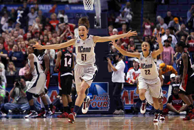 Cassie Kerns (center) and Meghan Gardler (right) celebrate Connecticut's 76-54 victory.
