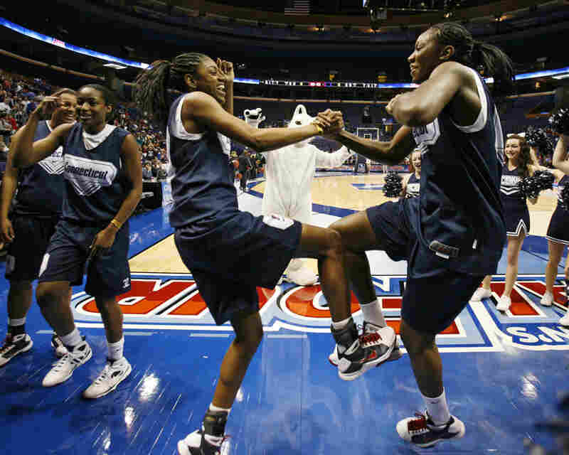 Charles (right) and Hayes loosen up after practice at the NCAA Women's Final Four.