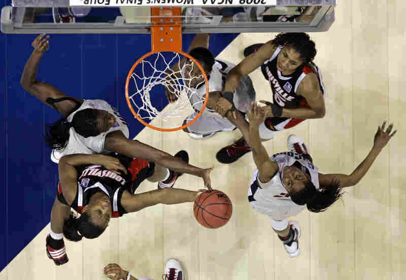 Connecticut was not the only team with an impressive season.  Louisville defeated two No. 1 seeds to make it to the national championship.  It was their first Final Four appearance.  Here, they compete with the Huskies' Charles (left), Moore (right) and Kalana Greene for possession.