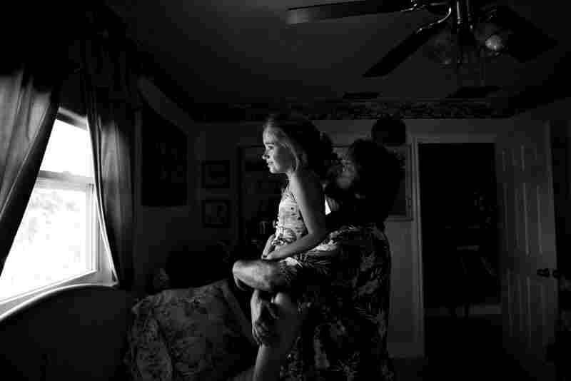 When Dani was in her biological mother's house, a small, dirty pane of glass in her tiny, dingy bedroom was her only window to the world. With her dad holding her tight with love, she still enjoys peering out of the windows in her new house, where the light washes over her and bathes her in warmth.