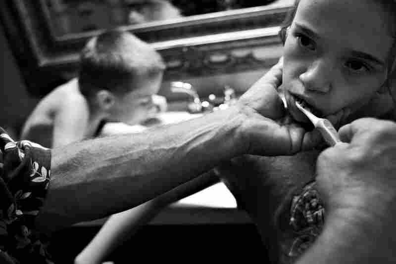 Brushing her teeth before bedtime requires help from her dad. Her brother Willie, 10, has no problem on his own, but Dani lacks the fine motor skills to handle such a simple task.