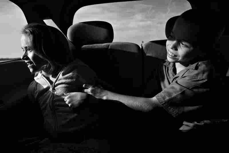 On the half-hour drive south to horse therapy, Dani stares out of the window of her family's SUV, while Willie tries to provoke a giggle through tickling her.