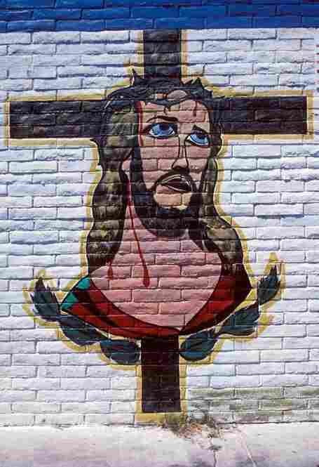 Latino blue-eyed Christ on the wall of a car wash, South Central Avenue, Los Angeles, 2003