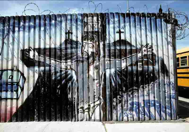 In this mural, barbed wire echoes the crown of thorns of the crucified Christ, Menahan Street, Brooklyn, N.Y., 2003