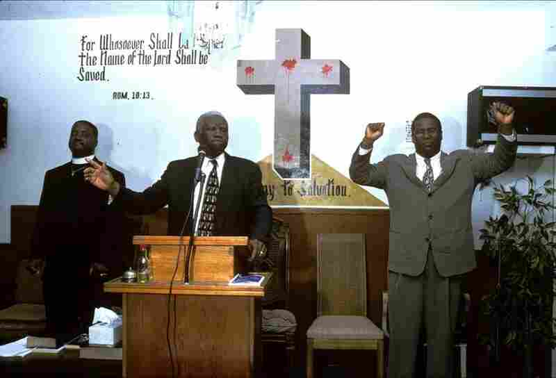 The body of Christ is not on the cross; he has risen.  Zion Church of God in Christ, a Pentecostal denomination, North Richmond, Calif., 2004