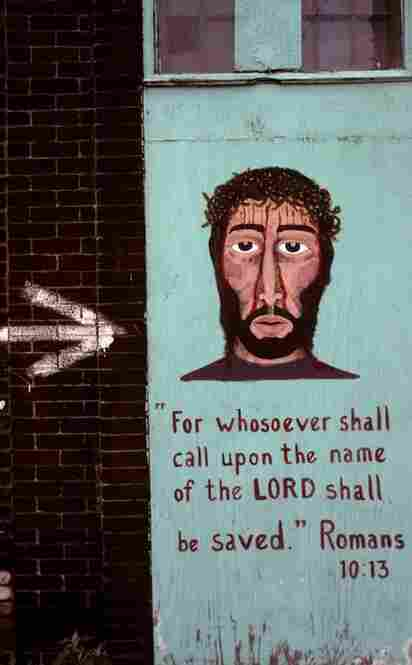 This image of the suffering Christ looking directly at the viewer was painted by an ex-convict.  Crossover Inner City Gospel ministry, Cass Avenue, Detroit, 1994