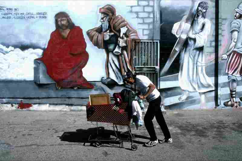 Murals sponsored by the local Catholic church to stem the number of gang killings in the neighborhood, Los Angeles, 1997