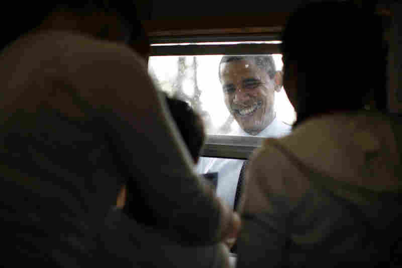 Obama buys tickets for food and rides at the Sombrero Festival in Brownsville, Texas.