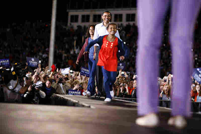 Obama and daughters Sasha and Malia join his wife, Michelle, at a campaign rally in Springfield, Mo.