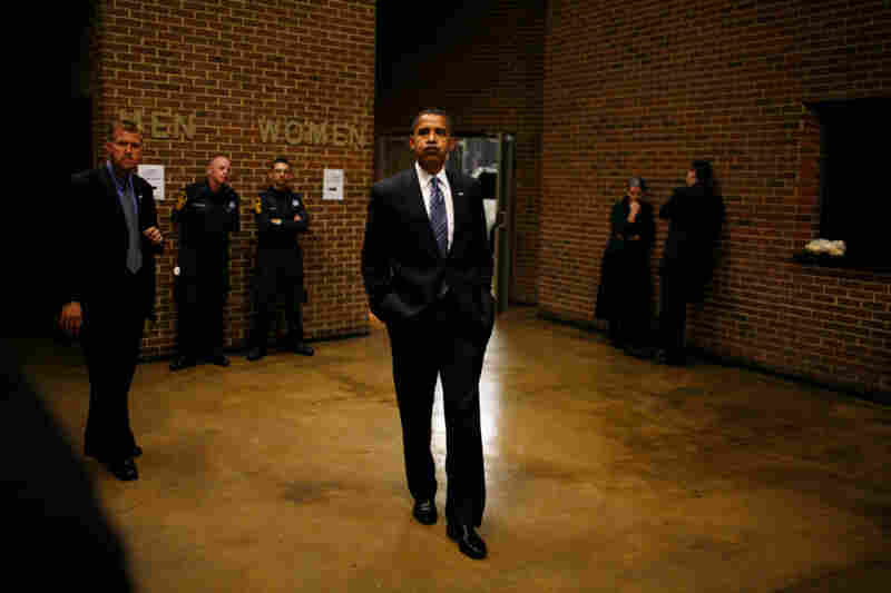 Obama waits backstage before a rally at the Richmond Coliseum in Richmond, Va.