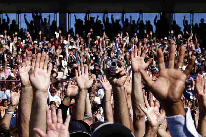 """A show of hands at a rally at Ed Smith Stadium in Sarasota, Fla.: """"Who makes under $250,000 a year?"""" Obama asked."""